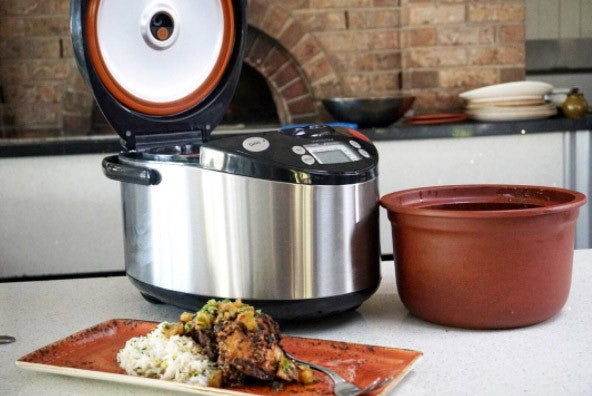 How is VITACLAY different from pressure cookers and conventional slow cookers?