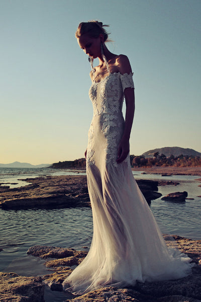 Off the shoulders wedding dress by Costarellos