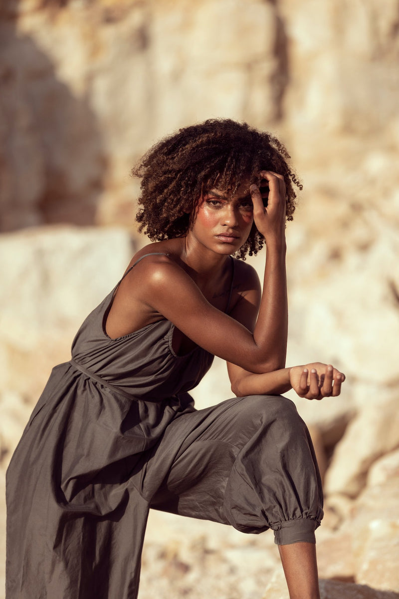 Model poses in quarry on shoot for Robe resort wear's third collection, Cocktails at Sunset, wearing The Sarah J jumpsuit in Charbon de Bois
