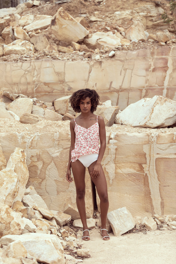 Model poses in sandstone quarry, wearing camisole singlet The Camille designed by Robe resort wear for women