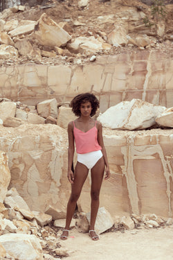 Model poses in quarry wearing pink camisole by Robe resort wear for women