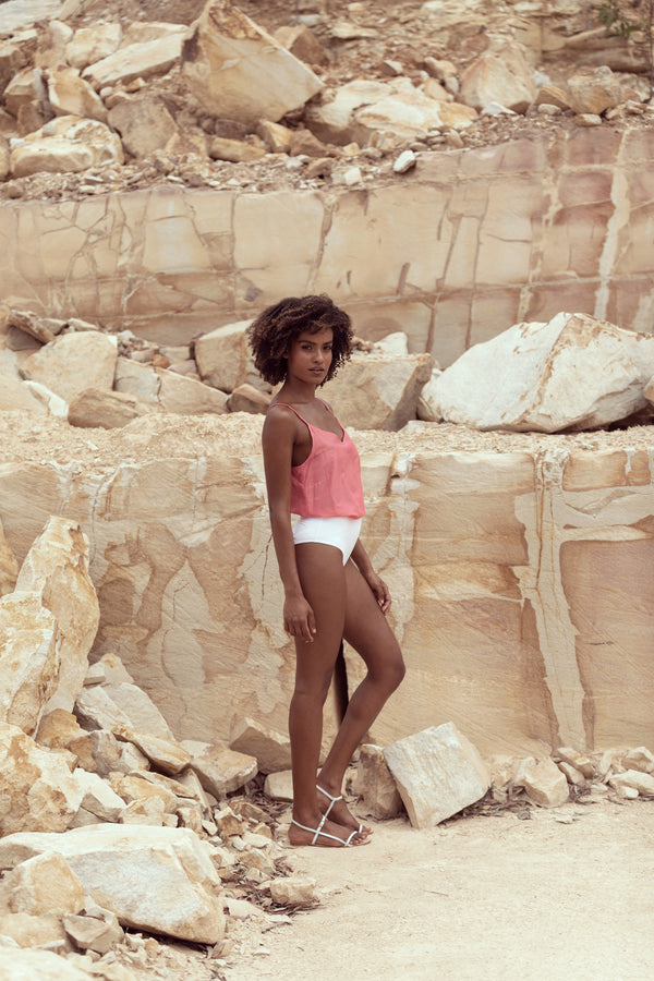 Woman models pink singlet The Camille by Robe resort wear in sandstone quarry