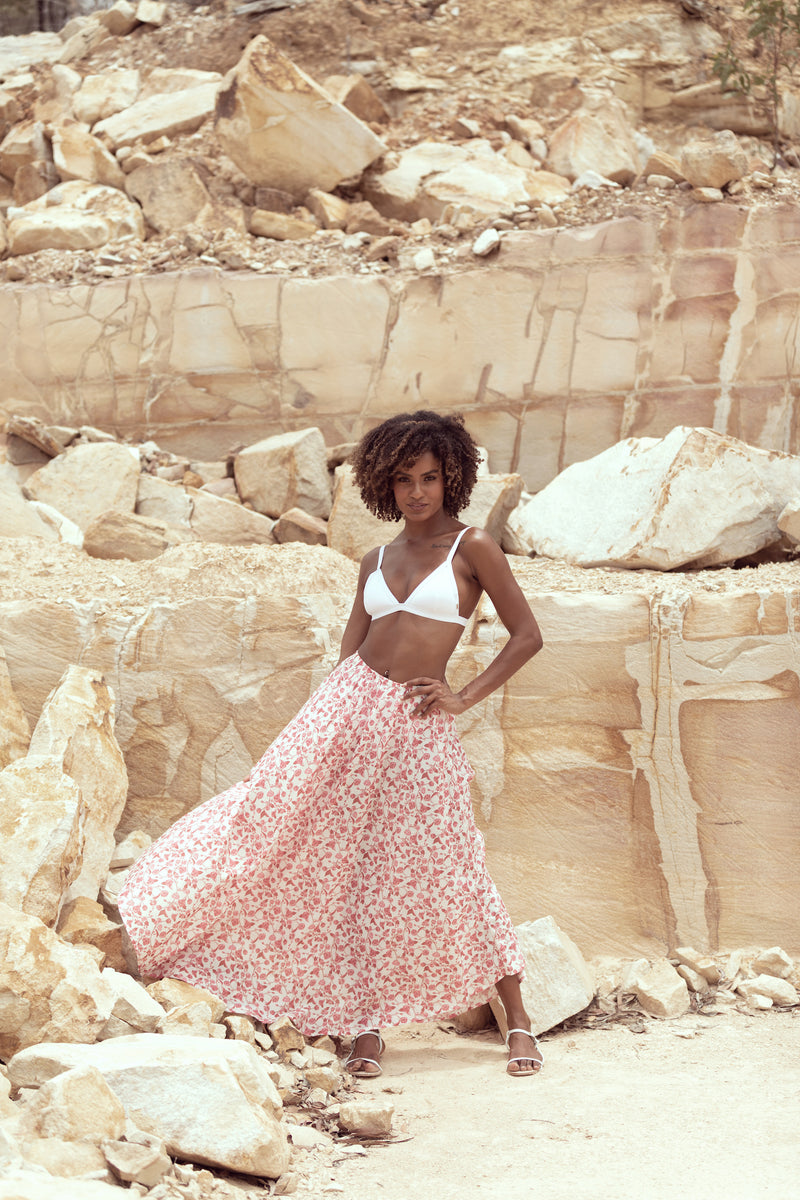 Brunette woman poses in sandstone quarry wearing The Jane in English Rose by Australian fashion label Robe