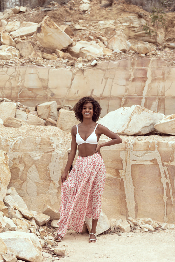 Model smiles wearing The Jane maxi skirt by Robe resort wear in sandstone quarry