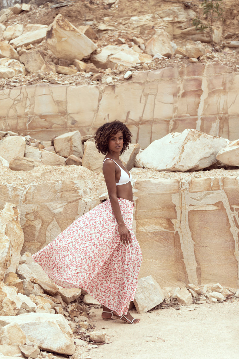 Model turns to side as maxi skirt The Jane by Robe resort wear catches wind in Queensland sandstone quarry
