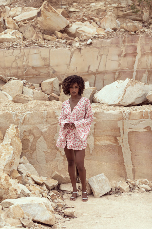 Woman stands in sandstone quarry in Queensland, modelling the Isabelle by Australian fashion label Robe