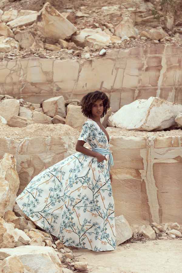 Model turns to side as her maxi dress catches the wind in a quarry while shooting for Australian label Get robed