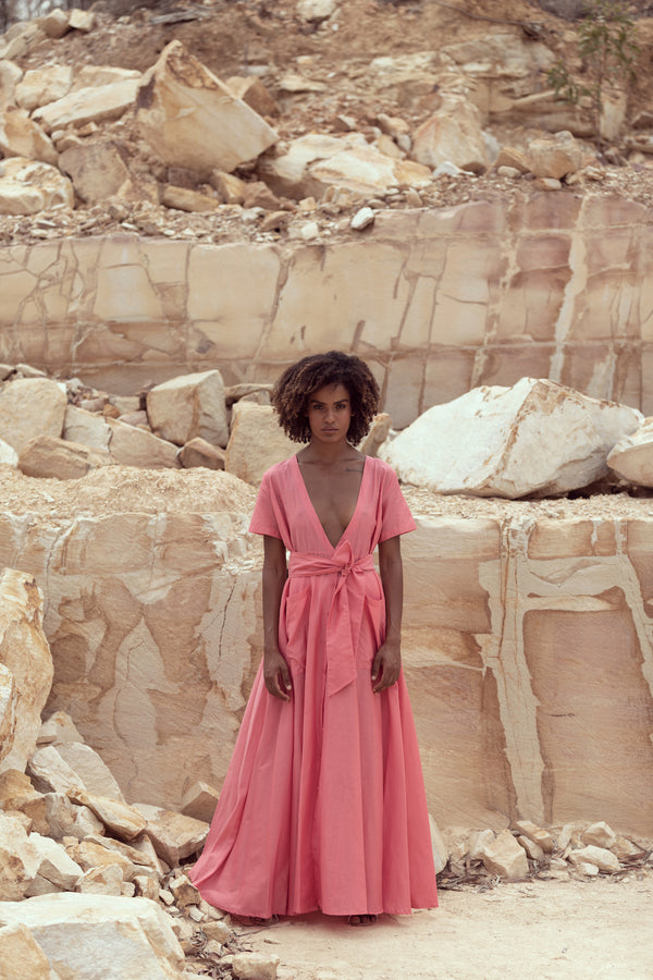 Woman models The Nikki II maxi dress in pink Candy Floss from Australian designer Robe's third collection: Cocktails at Sunset