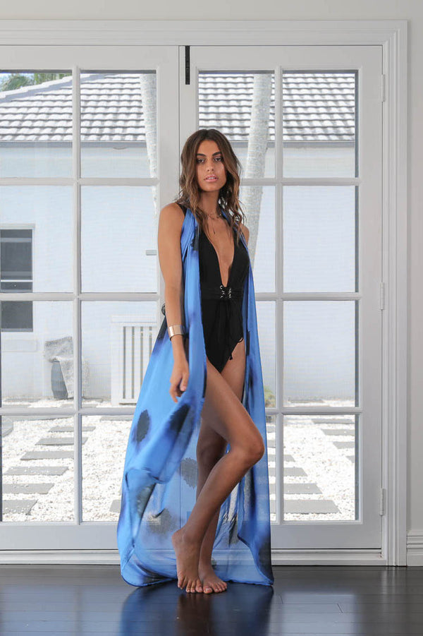 Model poses in blue sarong by Robe luxury resort wear