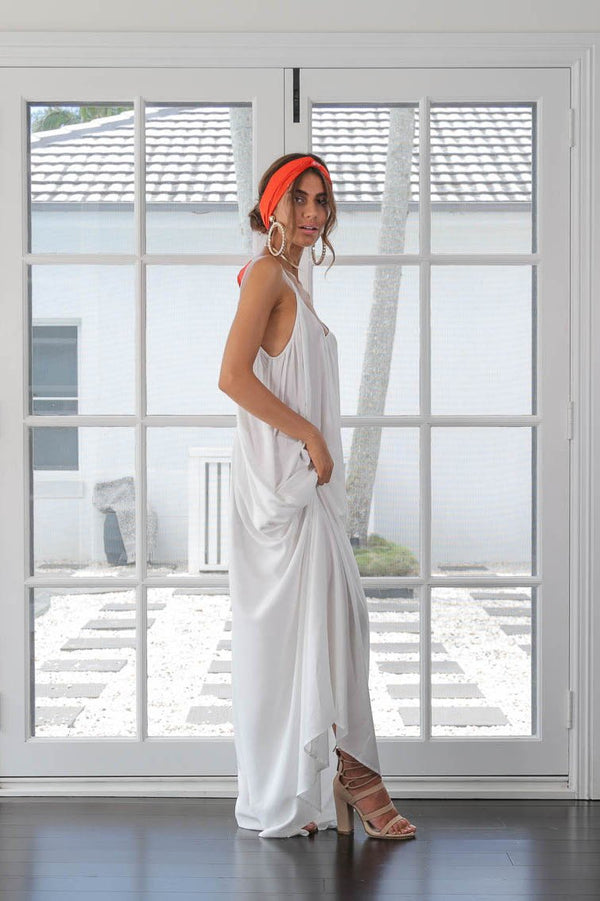 Model turns to side, wearing The Sarah in Snow maxi dress by Robe luxury resort wear