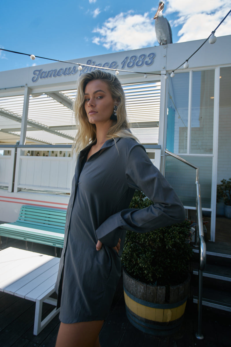 Blonde model stands at Watson's Bay Boutique Hotel, wearing The Bridget button up by Robe resort wear