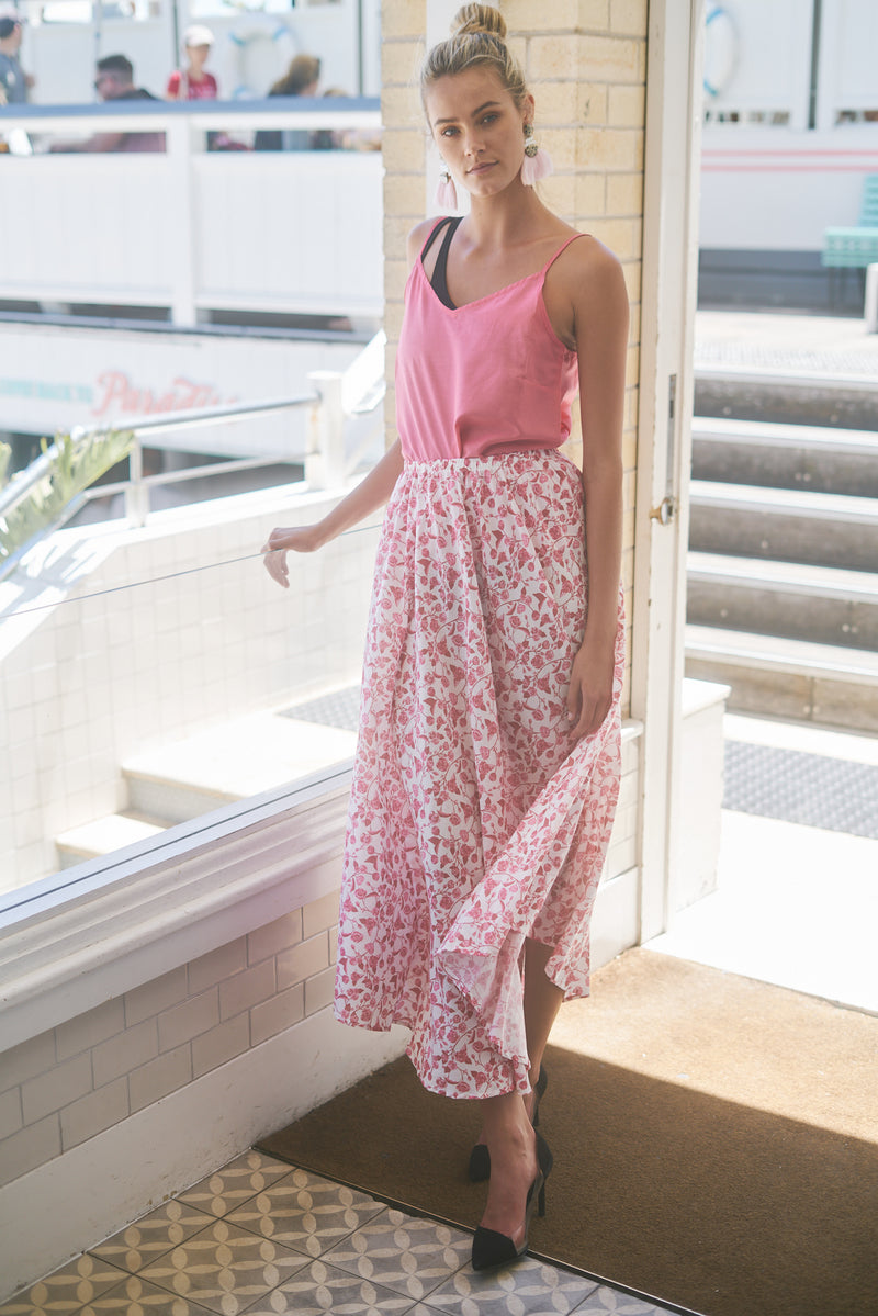 Blonde model stands in Watson's Bay Boutique Hotel, wearing pink camisole and floral maxi skirt The Jane in English Rose from Robe resort wear for women