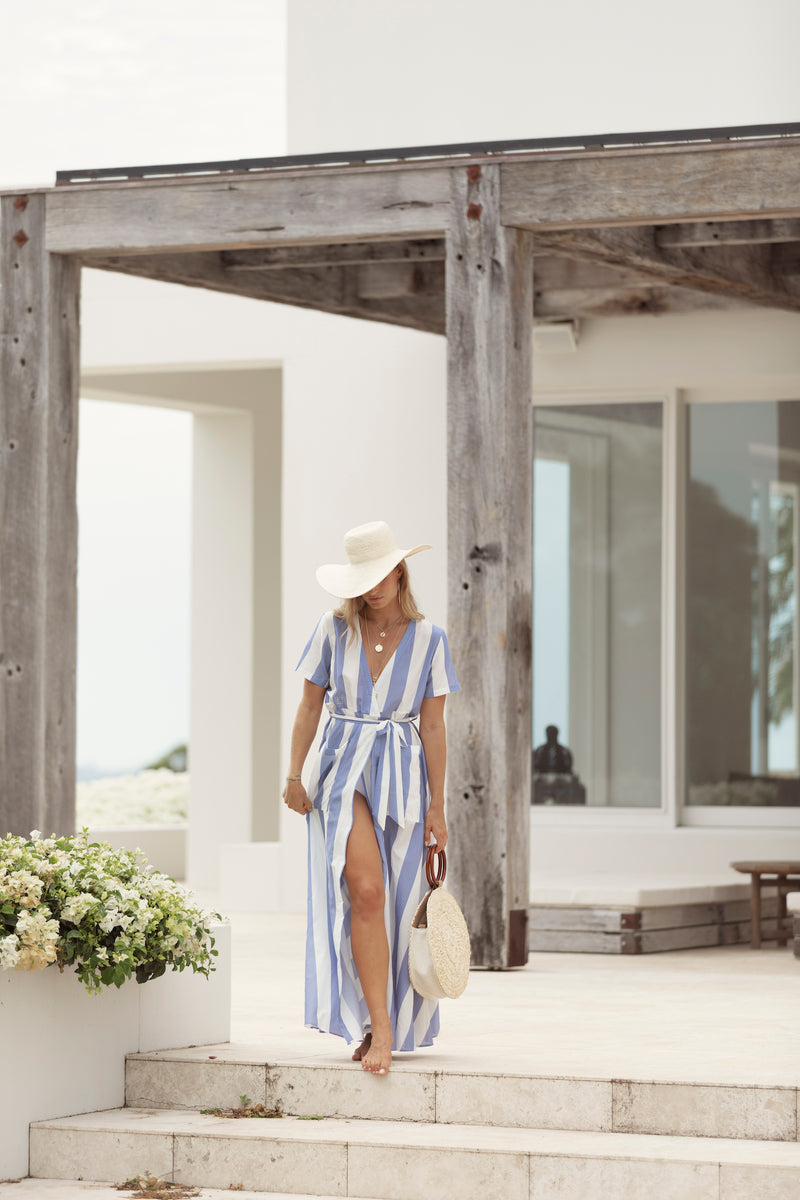 Woman is captured at Byron Bay resort, wearing blue stripe maxi dress The Nikki by Australian designer Robe