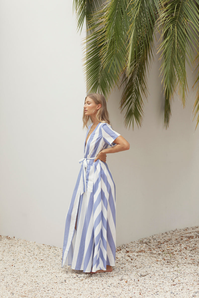 Model turns to side, showing off The Nikki maxi dress in Blue Streak from Australian fashion label Robe