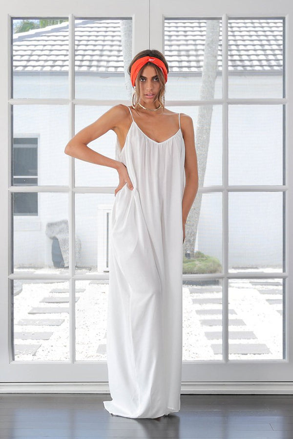 Model poses in the Sarah maxi dress in Snow by Robe resort wear