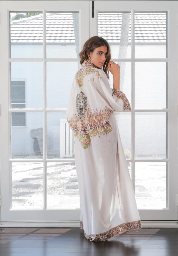 Model wears The Ollie kaftan in studio, showing off the statement print on the back - Robe luxury resort wear