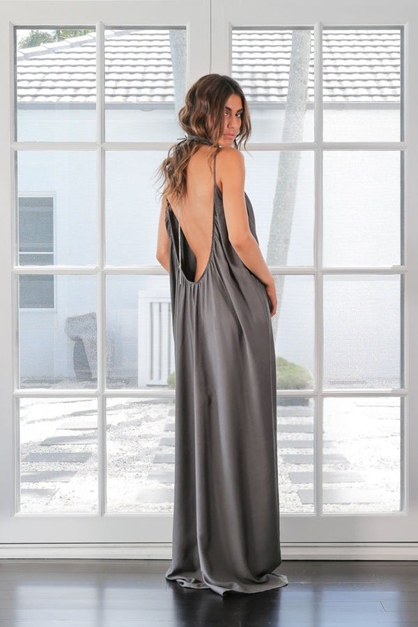 Model shows off the back of The Sarah maxi dress in Chardon de Bois by Australian designer Robe in studio