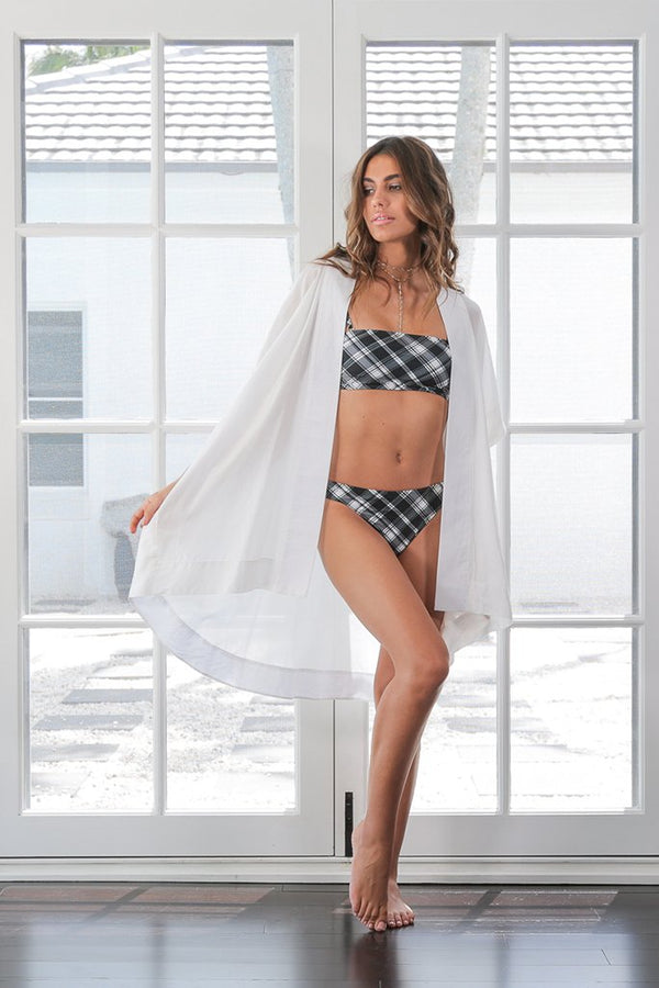 Model poses in studio, showing off kaftan The Sophia by Australian label Robe