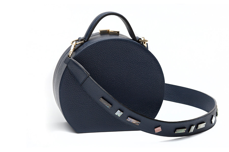 Nathalie Trad Oscar Clutch Bag-  midnight blue leather handbag embellished with shell and brass detail