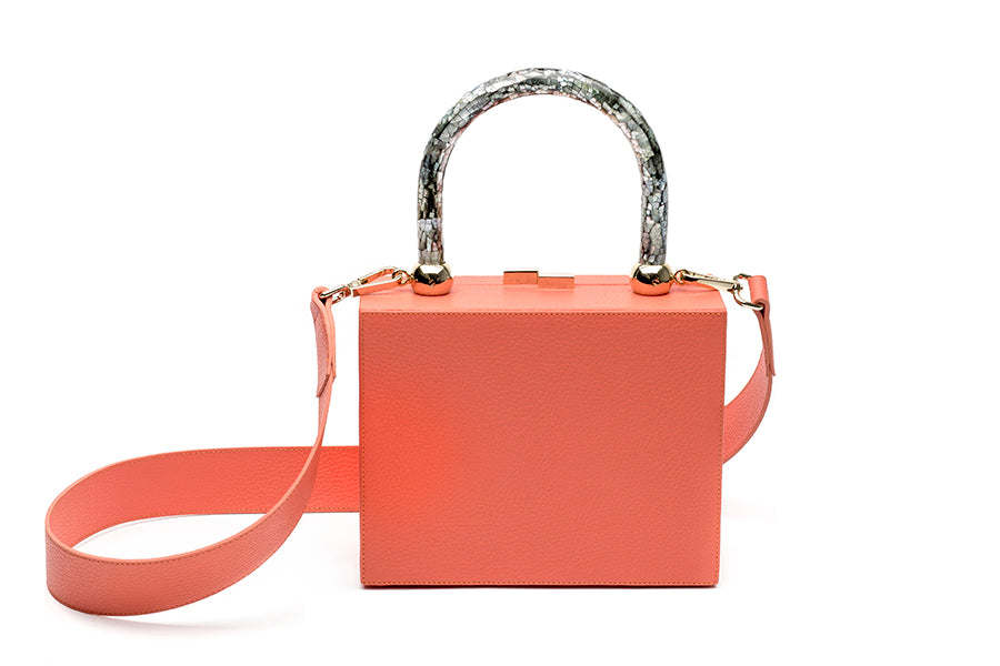 Nathalie Trad Otto Clutch Bag-orange leather clutch bag with Pink Hammer and Kabibe shell component details.
