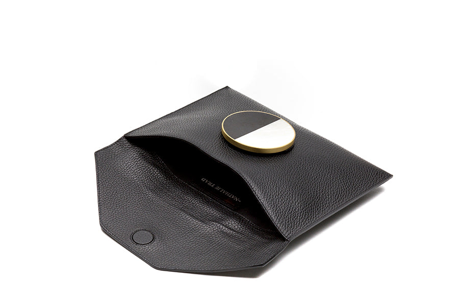 Nathalie Trad Rene Clutch Bag-black leather clutch bag with Black Tab and Kabibe shell component details.