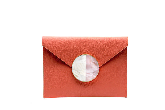 Nathalie Trad Rene Clutch Bag-orange leather clutch bag with Pink Hammer shell and Kabibe shell component details.