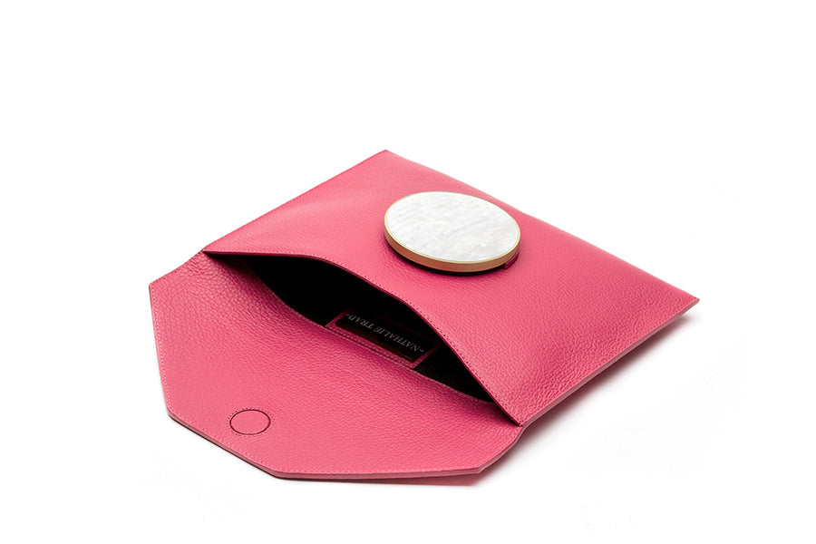 Nathalie Trad Rene Clutch Bag-pink leather clutch bag with Kabibe shell component details.