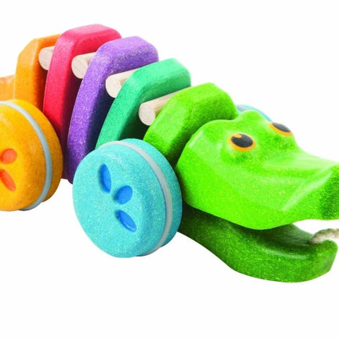 Rainbow coloured wooden pull along alligator