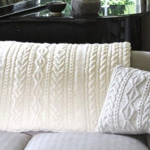 Cream knitted throw and cushion