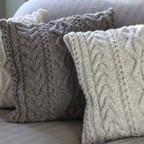 2 Knitted cushions in cream and grey