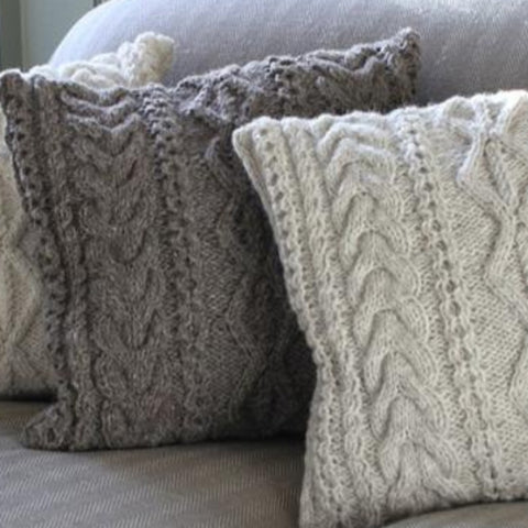 Knitted cushions in cream and grey
