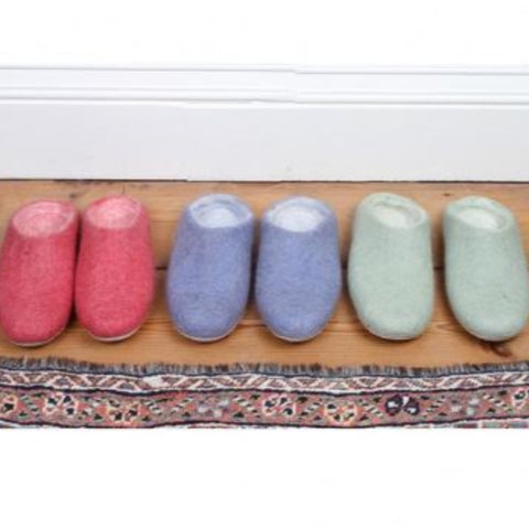 3 pairs of felted slippers in pink blue and mint green colour.