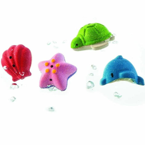 Set of 4 sea animals shell, starfish, turtle and dolphin.