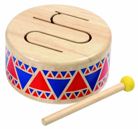 Wooden drum and stick with red and blue pattern around the outside