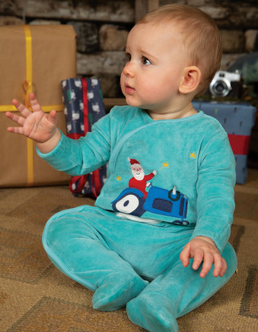 Topaz blue babygrow with santa on a tractor on the front