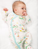 Babygrow white with pale blue trim and island and palm trees on
