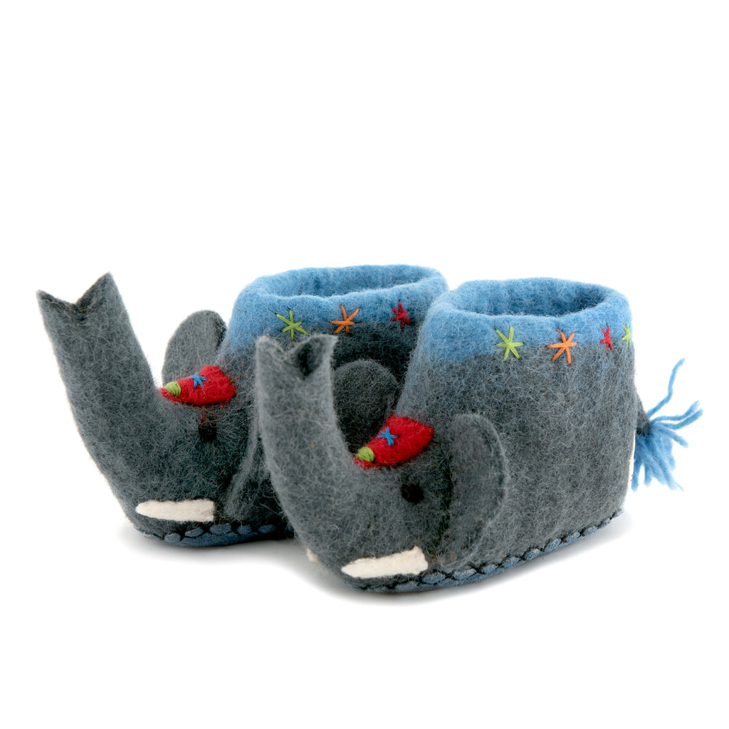 A pair of grey elephant shaped slippers with blue trims and tail.