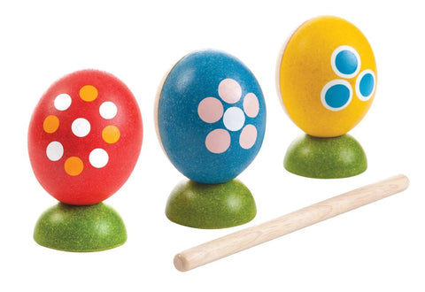 3 brightly coloured wooden eggs with beater