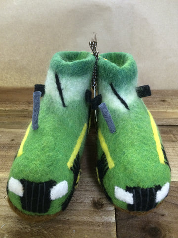 Mainly green felted tractor shaped slippers