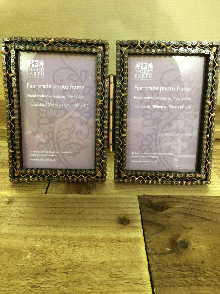 A double photo frame made with recycled bike chains