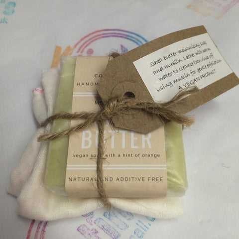Shea butter bar with muslin cloth and tag on the front