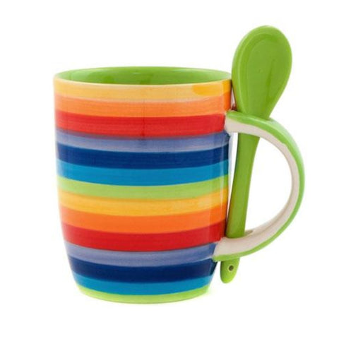 Mug with a spoon that sits in the handle, painted in rainbow stripes with a green inner
