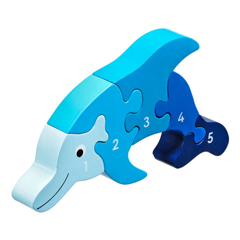 A 5 piece wooden jigsaw shaped like a dolphin in different shades of blue.