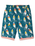 reversible shorts, blue with sail boats printed all over.