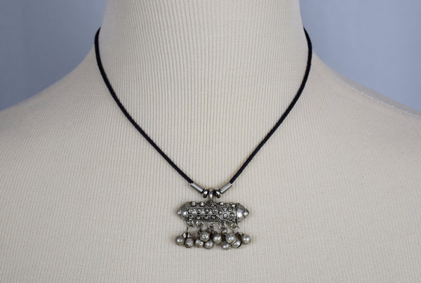 Silver pendent necklace with matching earrings