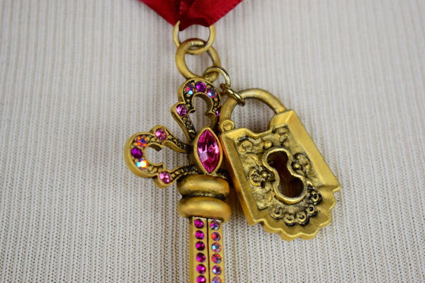 Red ribbon gold key and lock pendent choker