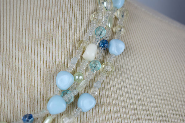 Powder blue beaded and gold pendent necklace