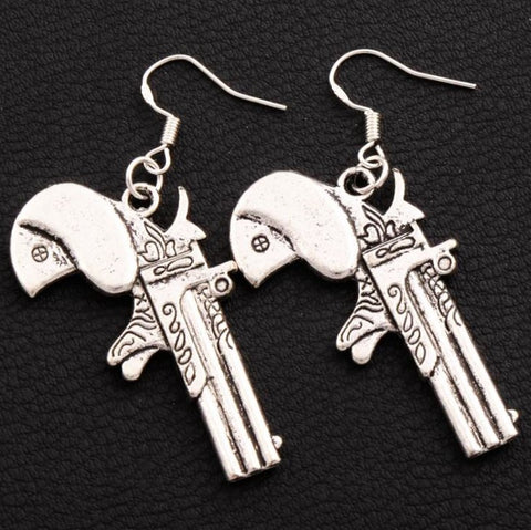 Dangle pistol shaped earrings at isellumonline.com