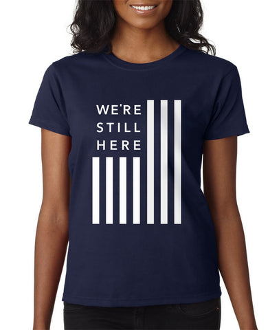 We're Still Here™ Flag Tee