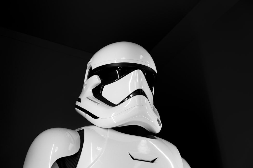 white and black storm trooper on black surface